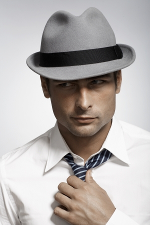 fedora: Mid adult man wearing fedora