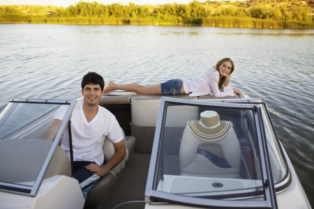 Young couple sailing with motorboat photo