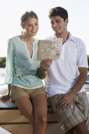 Young couple looking at map photo