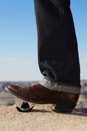 stetson: Cowboy boot treading miniature Stetson Stock Photo