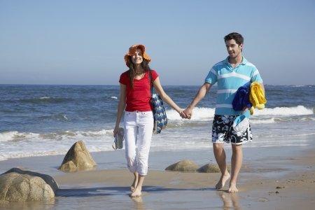 Young couple walking at beach photo