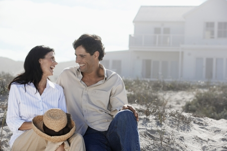 Couple laughing at beach photo