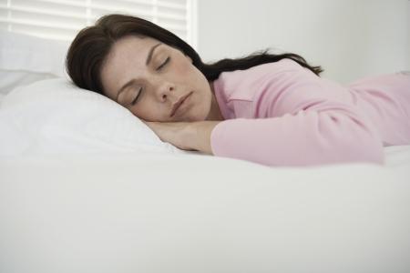 Mid adult woman sleeping photo