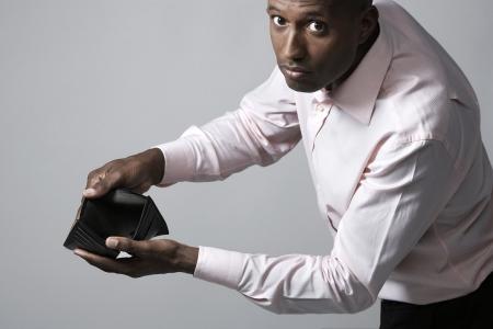 empty wallet: Businessman showing empty wallet Stock Photo