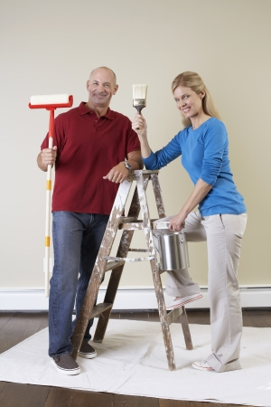 Mature couple decorating home photo
