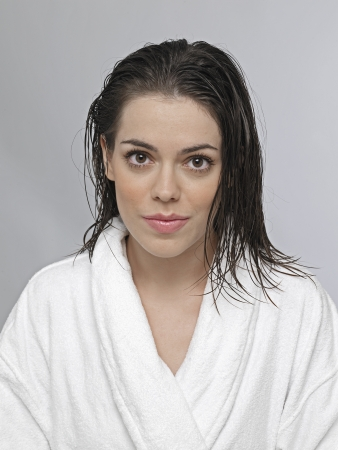 Young woman in dressing gown photo
