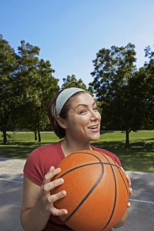 Mid Adult Woman Holding Basket Ball photo