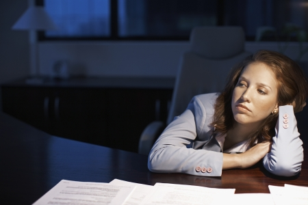 drudgery: Young Woman Working Late