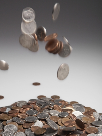 Coins Falling on Pile photo