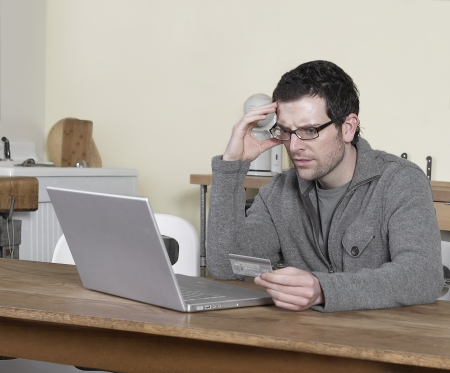 Mid-Adult Man Shopping Online photo