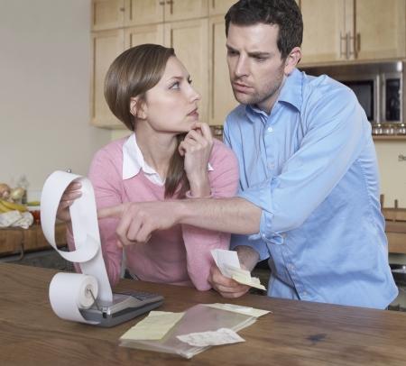 Mid-Adult Couple Examining Receipts photo