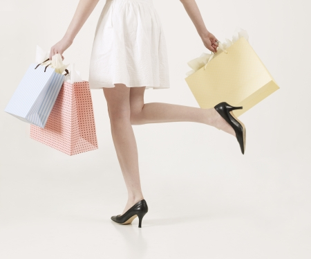 paper bag: Low Section of Young Woman with Shopping Bags Stock Photo