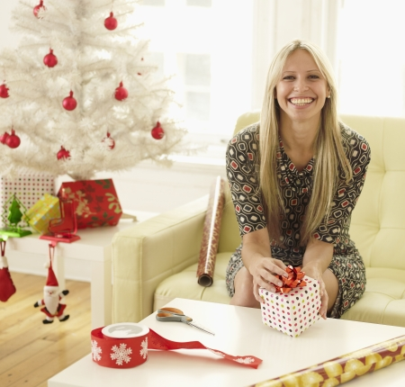 Mid-Adult Woman Wrapping Christmas Presents photo