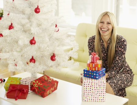 Mid-Adult Woman with Christmas Presents photo