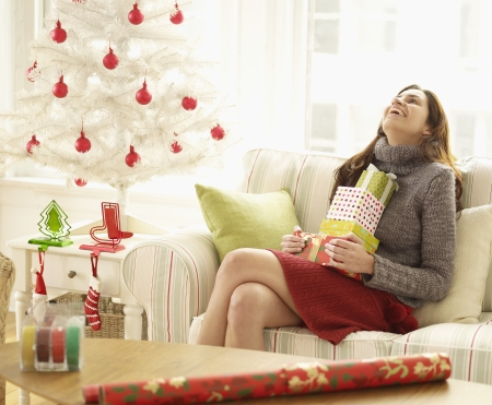 Mid-Adult Woman with Stack of Christmas Presents Laughing photo