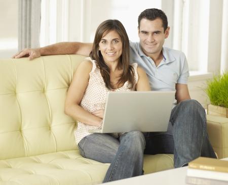 Mid-Adult Couple Using Laptop photo