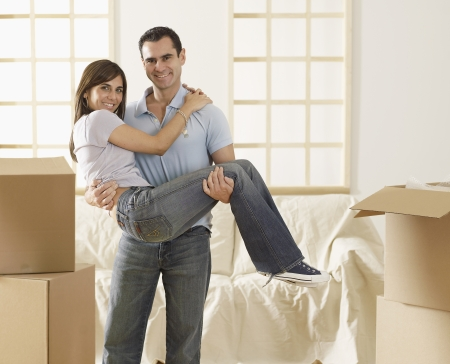carrying girlfriend: Man Carrying Girlfriend in Living Room