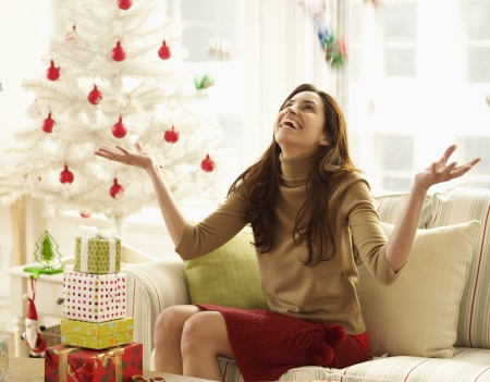 Mid-Adult Woman Tossing with Christmas Decorations Stock Photo - 23005089