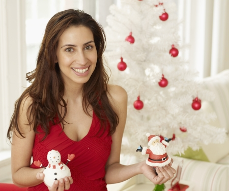 Woman Holding Christmas Decorations photo
