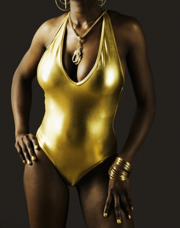 swimming costume: Young Woman in Golden Swimming Costume