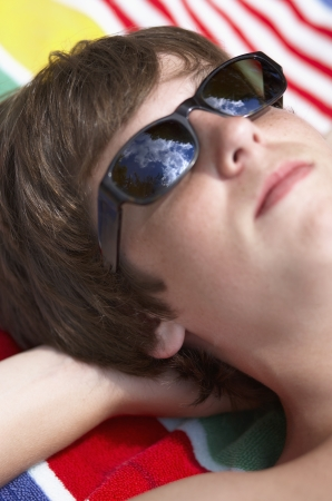 one person with others: Close-Up of Teenage Boy Relaxing