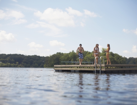 Three Teenagers Standing on Jetty photo