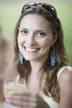 Mid-Adult Woman Drinking White Wine photo