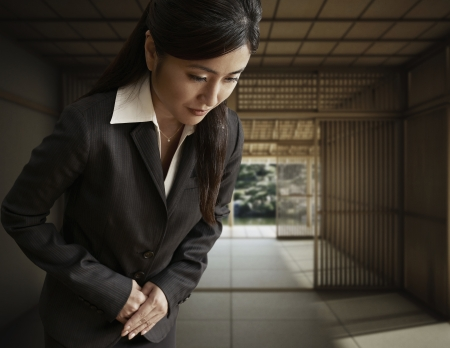 bowing: Businesswoman Bowing