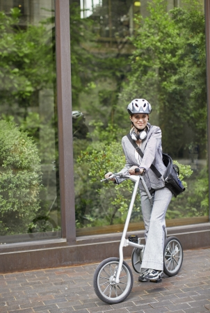 commuting: Businesswoman Commuting with Bicycle Stock Photo