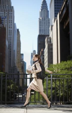 Businesswoman Running on Street