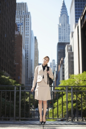 Portrait of Businesswoman by Skyscrapers photo
