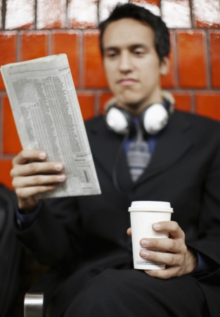 Young Businesswoman Reading Newspaper photo