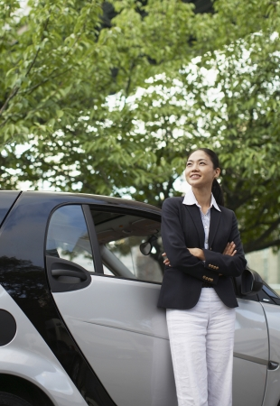 Happy Woman by Smart Car photo