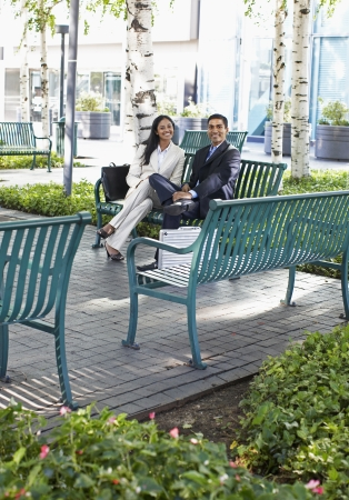 Two Businesspeople on Park Bench photo