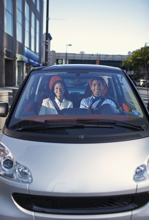 Mid-Adult Couple Driving Smart Car photo
