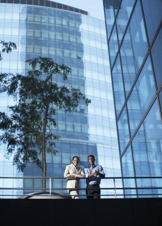 foot bridge: Portrait of Two Businesspeople on Foot Bridge