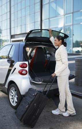 unloading: Businesswoman Unloading Smart Car