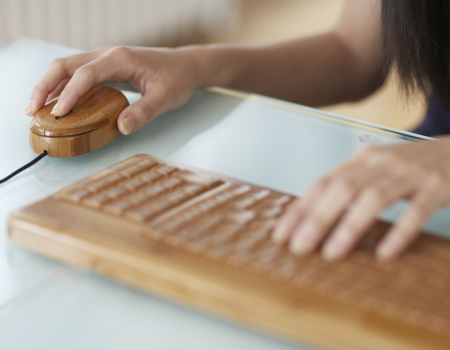 woman typing: Woman Typing With Wooden Keyboard Stock Photo