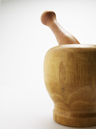 things that go together: Close-Up of Wooden Pestle and Mortar Stock Photo