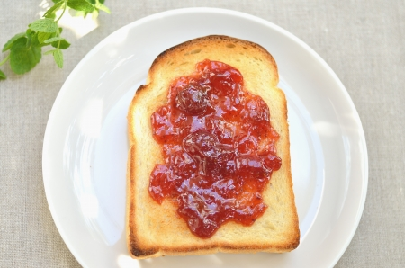 Jam and toast on a white plate photo