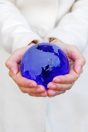 Two hands holding a globe photo