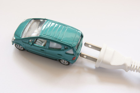 Miniature car with plug behind it photo
