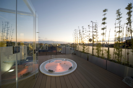 Outdoor bathtub with a sunset view Stock Photo - 26518304