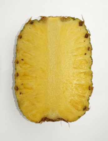 Pineapple cut into half photo