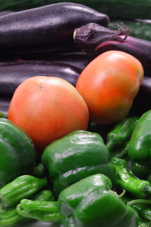 Green capsicum, fresh tomatoes and brinjals  photo