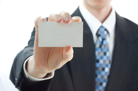Businessman holding a business card photo