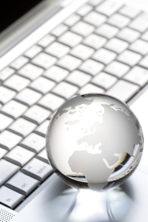 Glass earth globe on keyboard photo