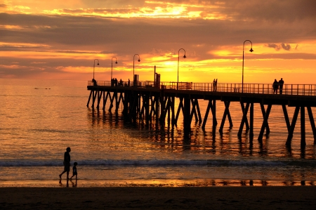 Sunset pier and Glenelg Stock Photo - 23690323