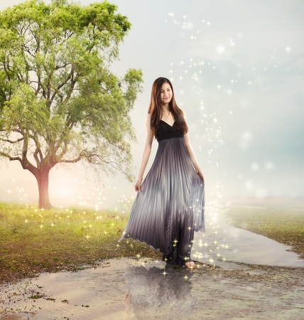 Beautiful Young Girl at a Magical River photo