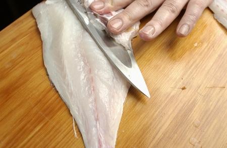 sea bream: Chef slicing sea bream,close up Stock Photo
